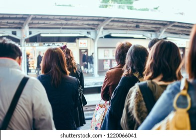 Japanese people queuing for boarding a train in Kyoto.Japanese people queuing for boarding a train in Kyoto.