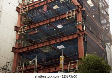 Japanese people working and build tower on construction site at Shinjuku district in Tokyo, Japan