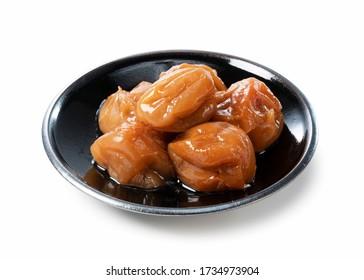 Japanese pickled plums on a white background. (Kishu Nanko Ume)