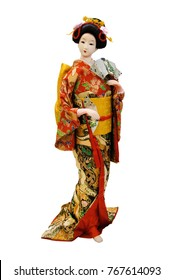 Japanese porcelain doll in the traditional kimono isolated on white