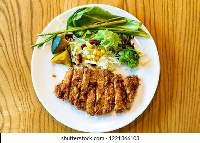 Japanese pork Tonkatsu homemade with fresh vegetable serve on table.