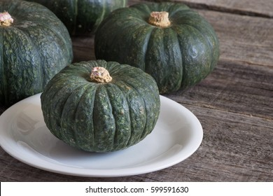 Japanese pumpkin on the old wooden table.