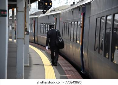 Japanese railway train and railway staff at Biei Hokkaido Japan