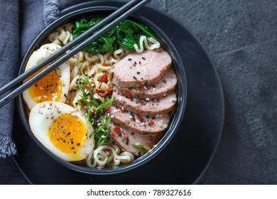 Japanese ramen noodle soup with duck breast, egg, chives and spinach