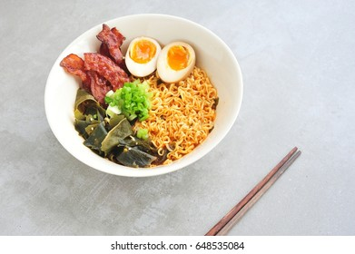 Japanese ramen soup with egg,bacon on gray background.
