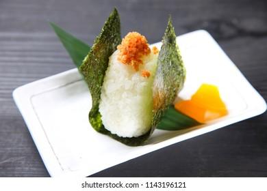 Japanese rice ball ONIGIRI with yellow pickled radish