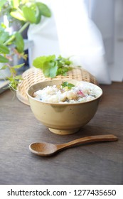 japanese rice congee with herbs and green vegetables