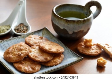 Japanese rice crackers with green tea. Beautiful tableware.