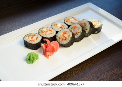 Japanese roll with crab meat, caviar,on a white plate
