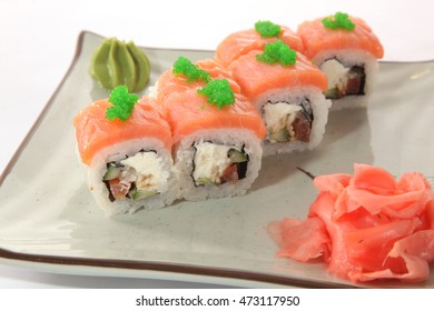 Japanese roll with wasabi sauce on plate with fish