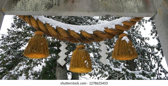 Japanese sacred Shinto ritual rope (Shimenawa) covered with snow
