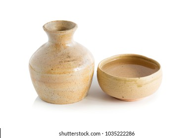 Japanese Sake drinking in ceramic jars and ceramic glass isolated on a white background.
