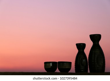 japanese sake oriental drink style on the table Silhouette background