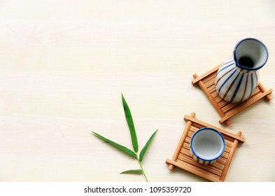 japanese sake oriental drink style and bamboo leaves on the table