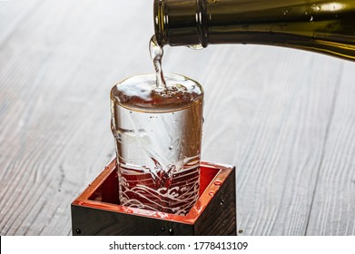 Japanese Sake poured in a transparent glass