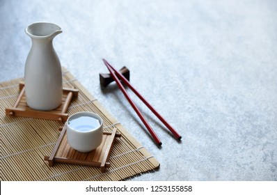 japanese sake set oriental drink style and chopsticks on the table