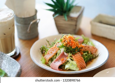 Japanese salad. Japanese gourmet of sashimi salad with selective focus on the salmon and tuna fish. Sashimi is a Japanese traditional food of a raw fish.
