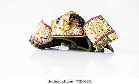 Japanese Samurai War Helmet Kabuto in Suji Bachi style during Mid Edo period. Multi-plated with ribs and wooden Shikami or Silvan head maetate and shikoro as neck guard. Isolated on white background.
