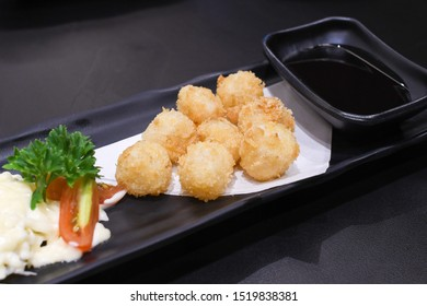 Japanese Scallop Kaibashira fried with breadcrumbs in japanese restaurant - closeup shot