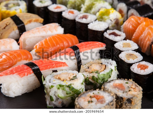 Japanese seafood sushi set on black background