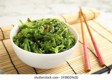 Japanese seaweed salad served on table, closeup