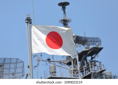 Japanese self defence force navy war ship and Japanese national flag