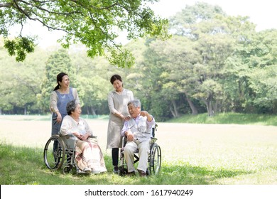 Japanese seniors receiving care by a couple