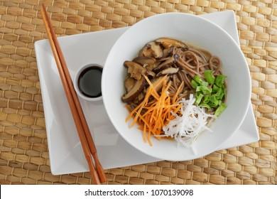 Japanese shiitake, soba, and vegetables soup