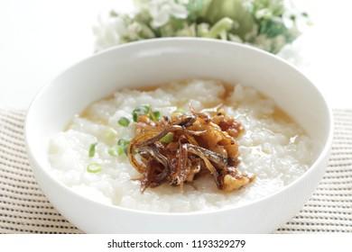 Japanese simmered sardines and walnut on rice porridge