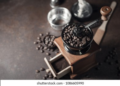 Japanese siphon coffee maker and coffee grinder on old kitchen table background, It is very fragrant and aroma because filled with fresh coffee beans.