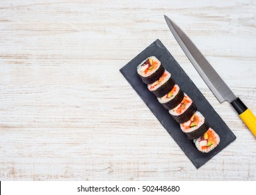 Japanese Sliced Sushi Rolls with Knife and Copy Space Area