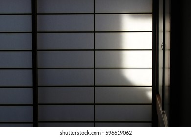 Japanese sliding door in the Japanese room with Sun shine on the sliding door