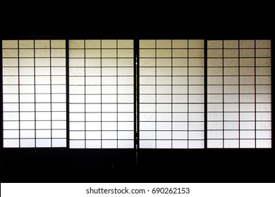 Japanese sliding screen panels with glimpse of outside garden