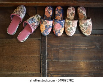 Japanese slippers on wooden floor in front of a Japanese House