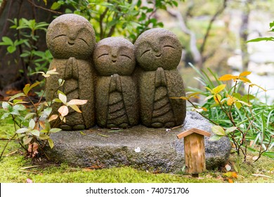 Japanese smile stone buddha monk statue (Jizo Bosatsu), Japanese believe that they can help protect tourists and children to survive, Hasedera Temple, Kamakura, Japan
