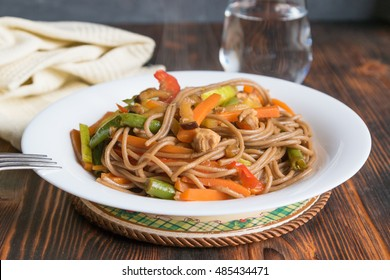 Japanese soba buckwheat noodles with vegetables and chicken