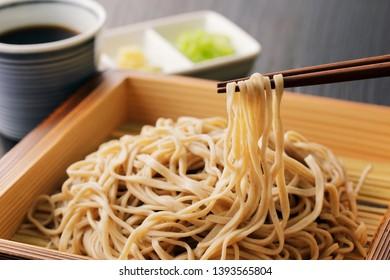 Japanese soba noodles on wooden board background