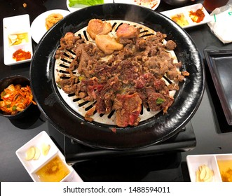 japanese spicy bulgogi or beef meat cooked on a frying pan and ready to eat with fresh vegetables, sauce, and kimchi