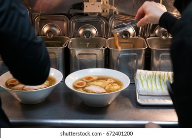 Japanese staff preparing noodles in Tokyo.