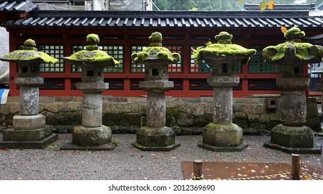 Japanese stone lantern at Futarasan jinja Shrine, Nikko, Tochigi, Japan. It is part of the World Heritage Site - Shrines and Temples of Nikko. - Shutterstock ID 2012369690