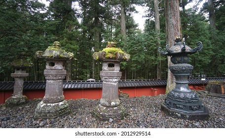 Japanese stone lantern at Tosho-gu shrine, Nikko, Tochigi, Japan. It is part of the World Heritage Site - Shrines and Temples of Nikko. - Shutterstock ID 2012929514
