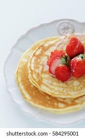 Japanese strawberry and condensed milk on homemade pancake