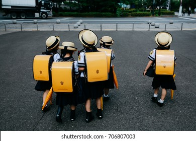 Japanese student with yellow school bag and hat