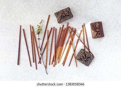 Japanese style gift boxes (Furoshiki) and chopsticks on concrete background.
