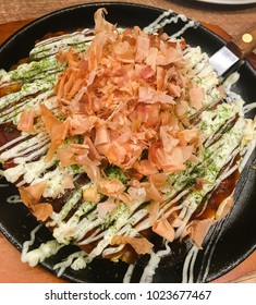 "Japanese style pizzas were called. ""Okonomiyaki"". It's a dough that is mixed with vegetables and squid and then roasted on a hot pan. Topped with mayonnaise sauce"