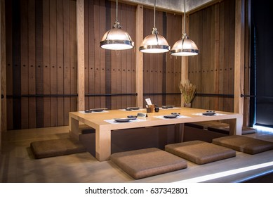 Japanese style restaurant, Wood table center and cushions and 3 lighting