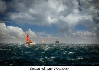 A Japanese submarine sits in Tokyo off the coast of Yokosuka, Japan near the breakwater light.