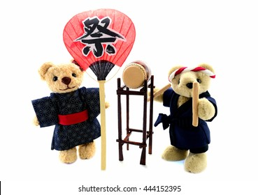 Japanese summer festival /the girl with a fan which was written with the festival and the boy hit the taiko