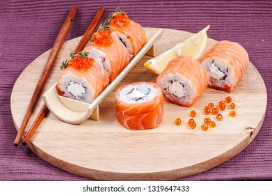 Japanese sushi with caviar on a wooden stand close-up