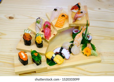 Japanese sushi food. Maki ands rolls with tuna, salmon, shrimp, crab, Algae,Sweet egg,Salmon roe,Top view of assorted sushi, all you can eat menu. Rainbow sushi roll, uramaki,Served on wood